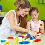 bigstock-Nursery-teacher-and-girl-cropped