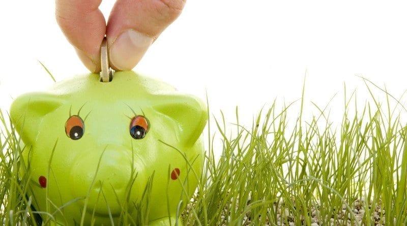 bigstock-saving-money-on-a-piggy-bank-o-22440992