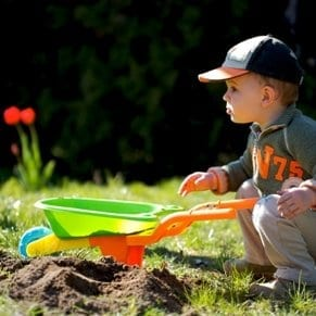 Child playing in garden