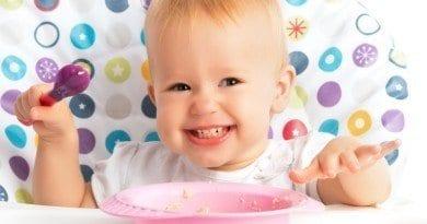 bigstock-Happy-Baby-Child-Eats-Itself-Copy