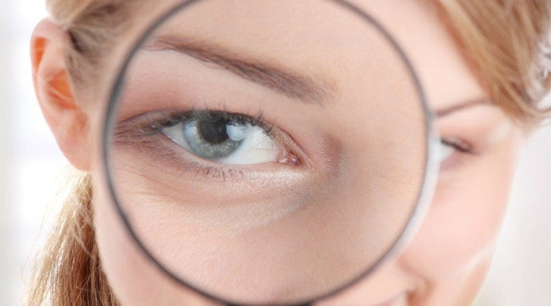 bigstock-The-woman-with-a-magnifier-in-copy