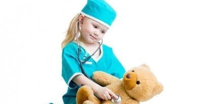 child playing doctor with teddy