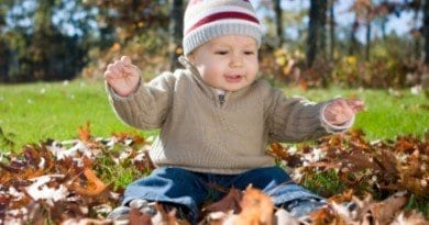 boy_playing_leaves_autumn
