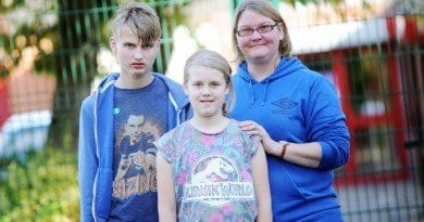Justine Shepherd with her children Anna 11 and George 16 who went to Susan Isaacs Nursery. Pictured by Richard Holton 28th Sept 2015 Copyright Bolton News(Newsquest)