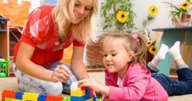 bigstock-Teacher-and-child-are-playing--26401664