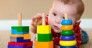 bigstock-Baby-boy-playing-with-stacking-68305069
