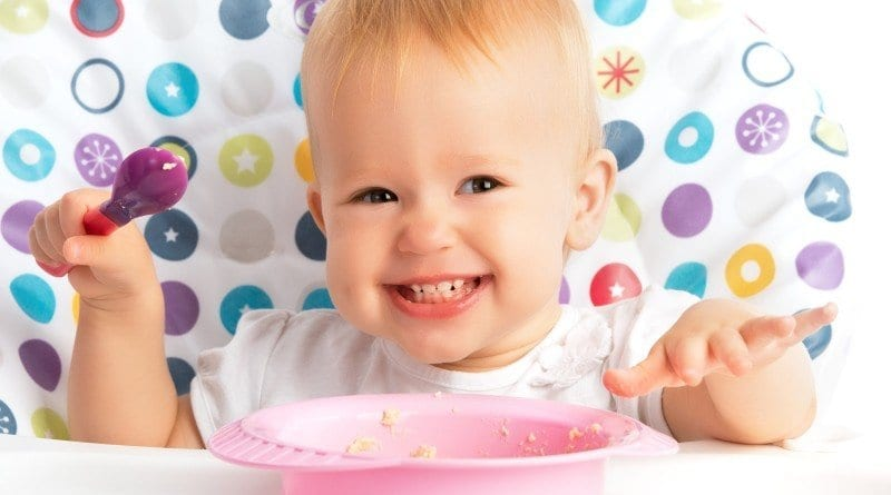 bigstock-Happy-Baby-Child-Eats-Itself-Copy