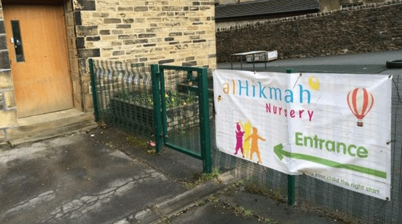 View of the exterior of a nursery, showing their banner alHikmah Nursery