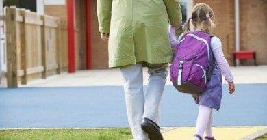 48849376 - parent taking child to pre school