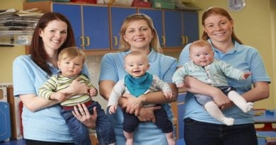 49364055 - group of workers with babies in nursery