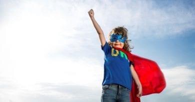 Boy in superhero cape