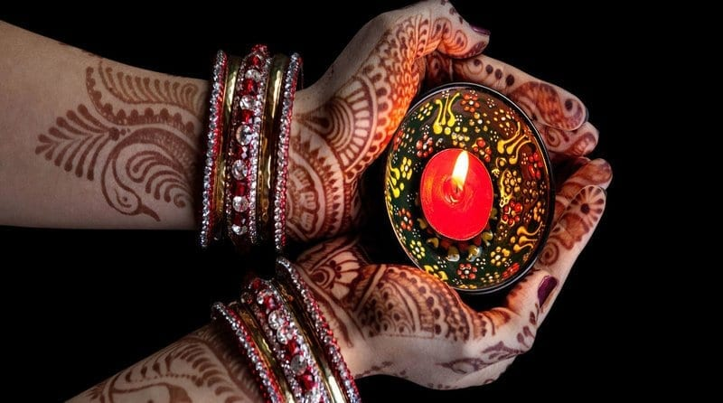 Woman with Henna holding candle