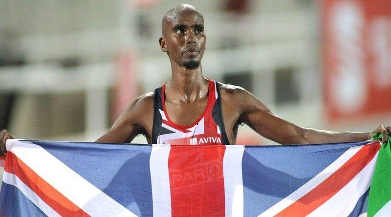 Mo Farah holding British flag