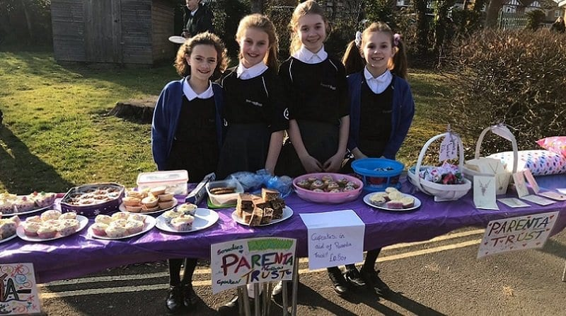 Schoolchildren raise £180 for the Parenta Trust by selling cakes