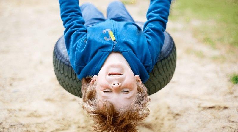 Child swinging on a tyre swing