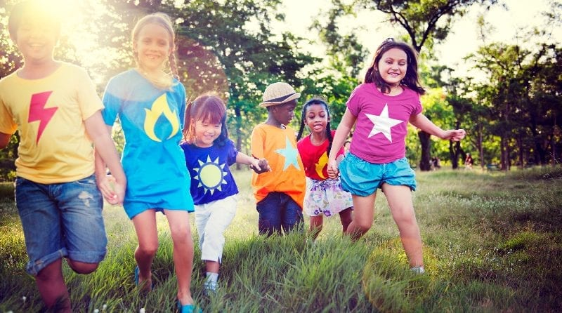 Group of children running in a field, The ideas of the Behaviourists