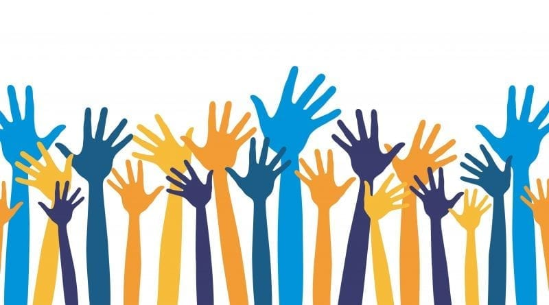 vector image of colourful hands being raised in the air