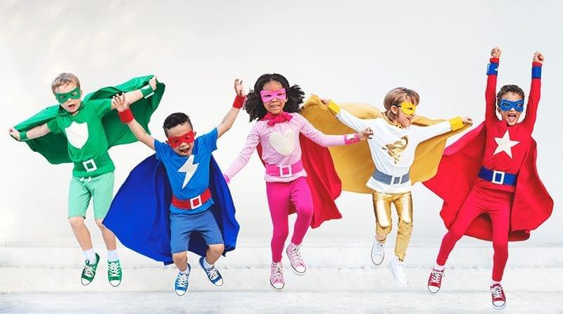 A group of children dressed up as superheros