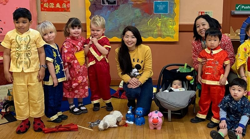 Children at nursery dressed up in traditional Chinese outfits
