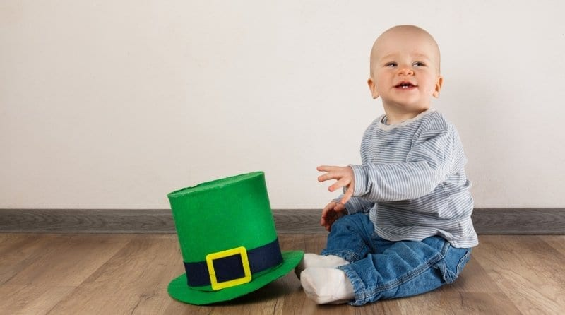 Little boy with Leprechaun hat sitting on the floor on St Patrick's Day.