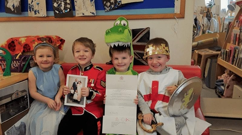 children at nursery smiling after they recieved a letter from Duchess of Sussex