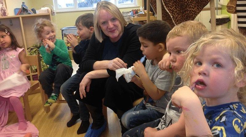 children at nursery brushing their teeth