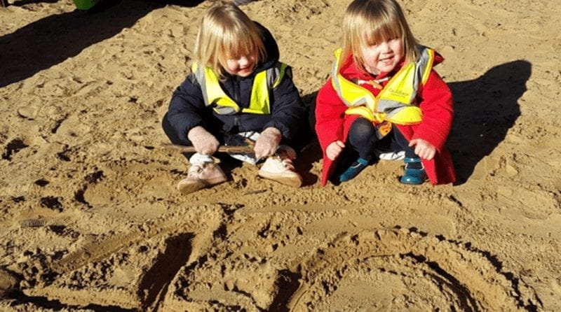 Two little children playing on the beach