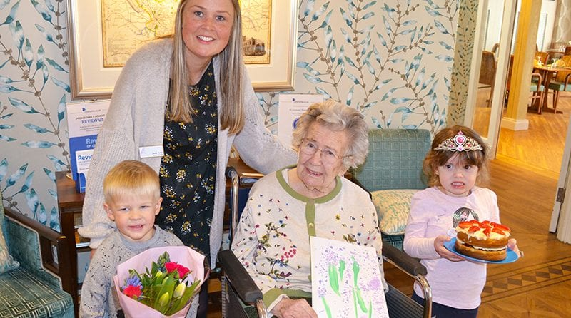 Nursery school children visit Richmond Nantwich Care Home with flowers, a cake, and a card made by the children, to celebrate a residents 104th birthday