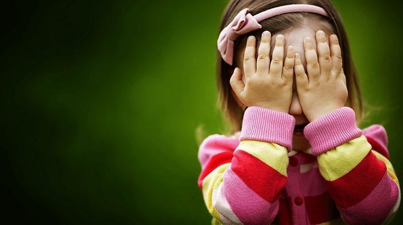 Little pre-school girl with her head in her hands