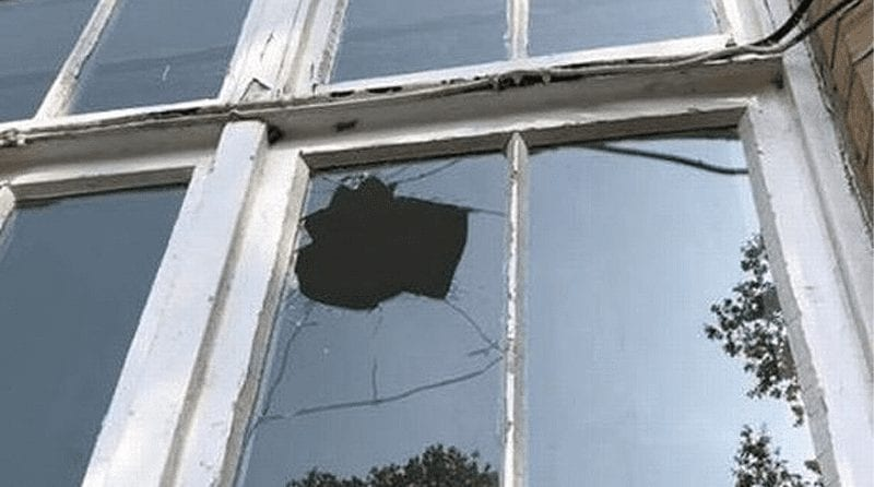 Smashed window of nursery where a rock has been thrown through