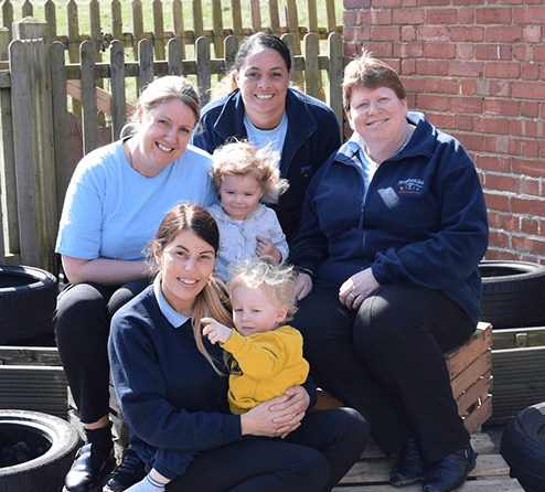 Pictured are Annabelle Blackwell, 2 and Theo Rex-Bowland, 1, with (l-r) Outgoing Owner Emma Acors, Bright Kids Head of Operations Emma Beard, Bright Kids Group Owner Tricia Wellings and Coughton Nursery Manager Josie Richardson (front).JPG