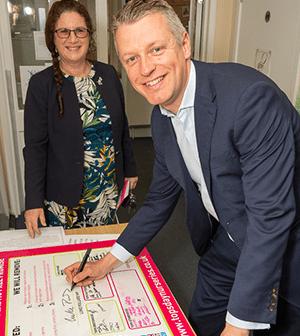 MP Luke Pollard and MD of Tops Day Nurseries, Cheryl Hadland, pose signing the Tops Day Nurseries pledge