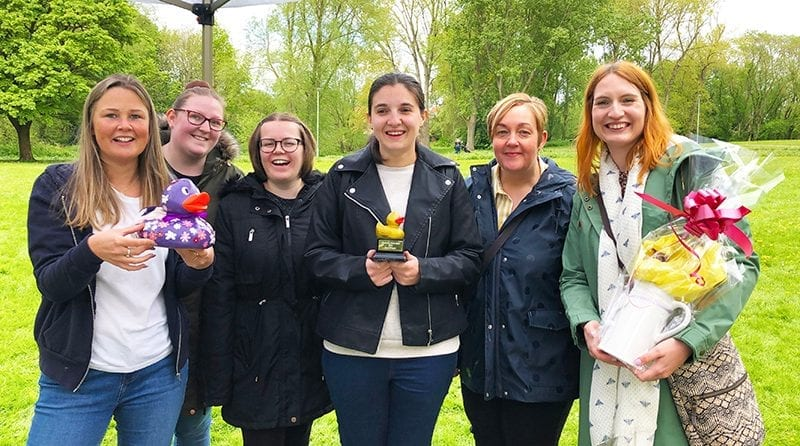 Elmscot Nantwich goes quackers over duck race triumph, Staff from Elmscot Day Nursery and Nursery School Nantwich stand proudly with their duck that won the race (Elmsquack) and the golden duck prize
