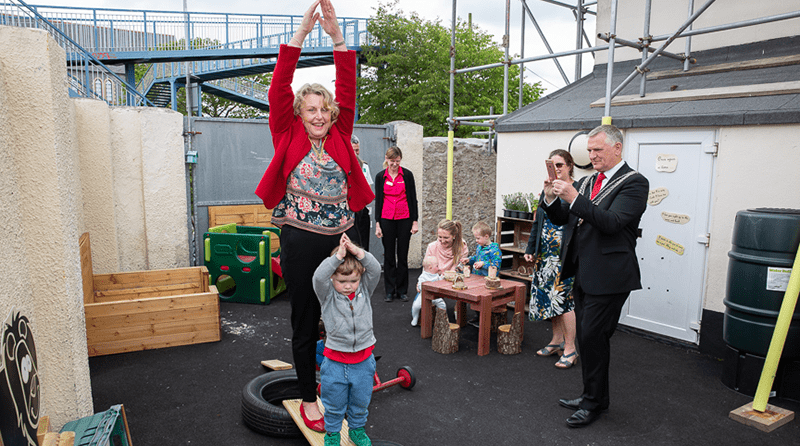 Plymouth's Deputy Lord Mayor and Deputy Lord Mayoress exploring Tops Day Nurseries Cattedown's play garden