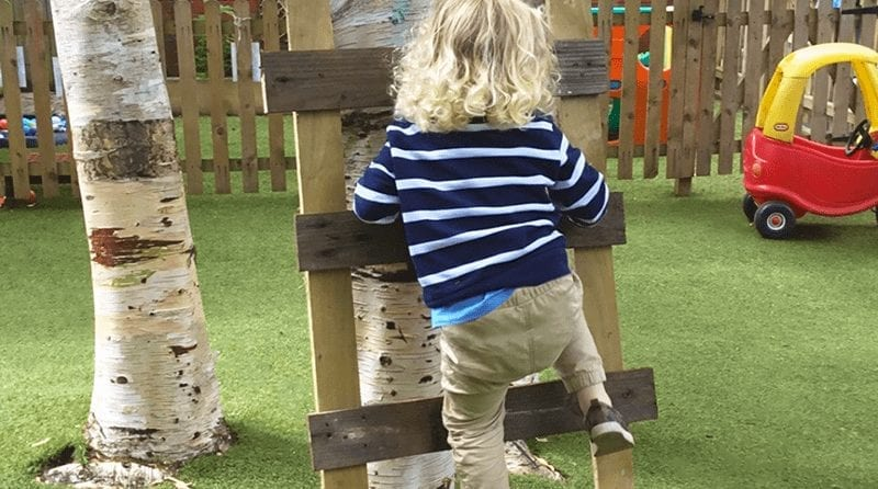 Elmscot Broussa Nursery child reaches greater heights, Little child climbing the ladder they build to climb the tree