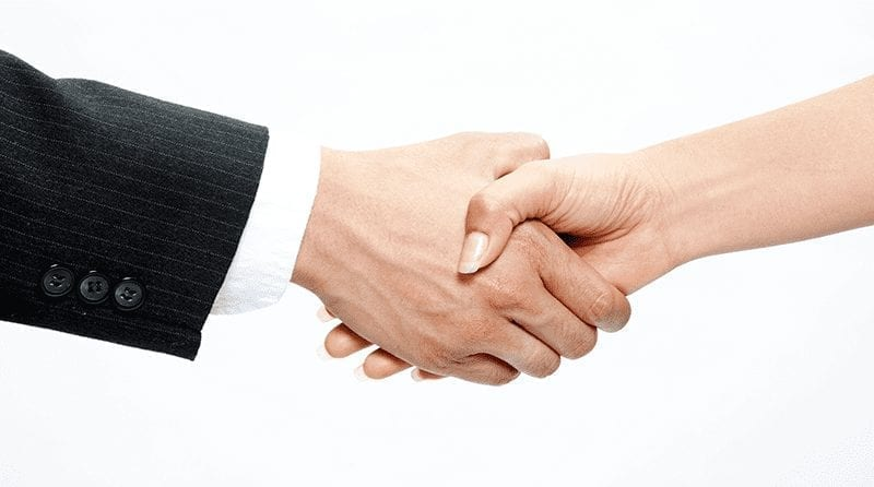 A close up of just hands - a man and a woman shaking hands