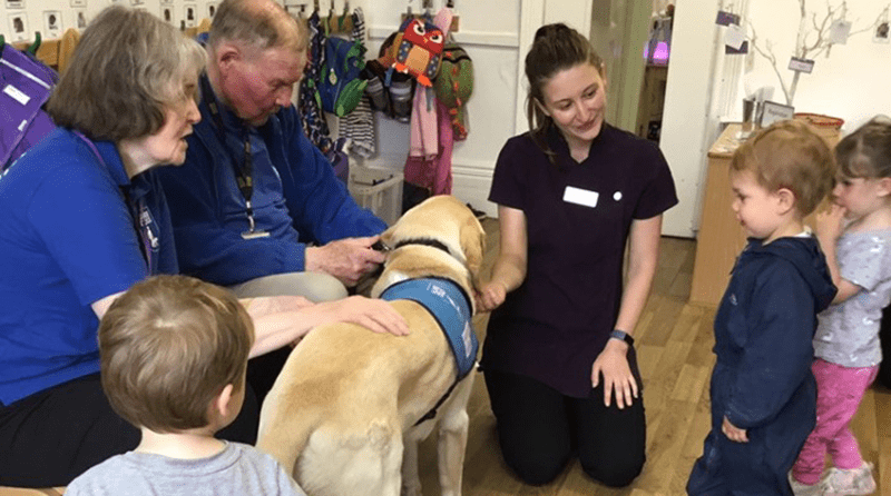 Broussa Day Nursery children welcome local guide dog