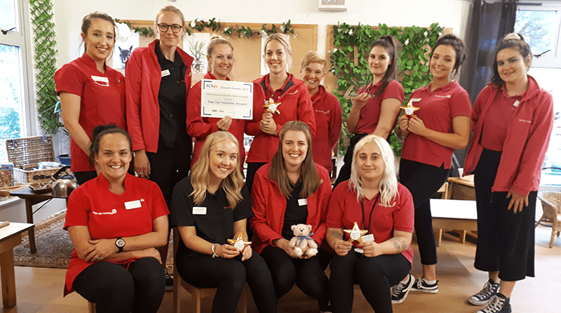 Tops Day Nurseries Newport celebrate 'Nursery of the Year' award with IOW College