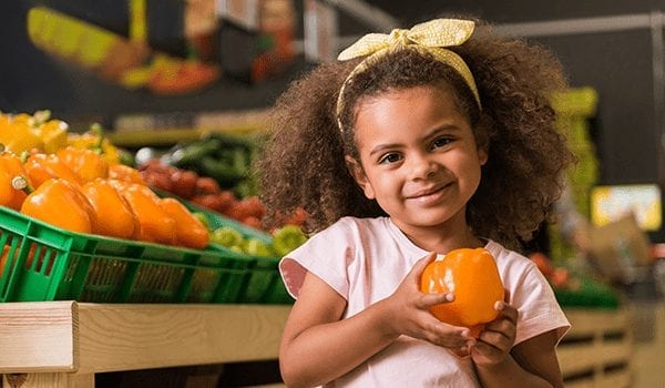 How is the government encouraging healthy eating through the implementation of taxes?